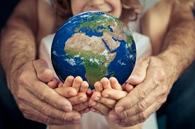 Image of Family Holding Earth Planet in Hands